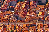 stock photo of red roof  - Dubrovnik Croatia red tiles on the roofs top view overlooking the town - JPG