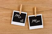 stock photo of clotheslines  - Photo papers hanging on the clothesline on wooden background - JPG