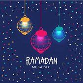 stock photo of ramadan mubarak card  - Colorful illuminated hanging lanterns on stylish blue background - JPG