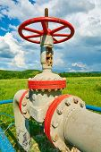 image of gas-pipes  - Gas pipe with a tap valve in the summer - JPG
