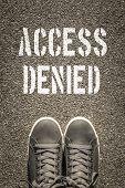 picture of denied  - Access Denied stencil print on the asphalt road - JPG