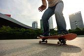 image of skateboard  - closeup of skateboarder skateboarding at sunrise city - JPG