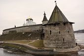 picture of fortified wall  - Stone tower and Pskov Kremlin fortress wall at the confluence of two rivers - JPG