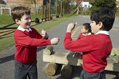 stock photo of playground school  - Two Boys Fighting In School Playground - JPG
