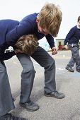 foto of playground school  - Two Boys Fighting In School Playground - JPG