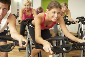 pic of fifties  - Group Taking Part In Spinning Class In Gym - JPG