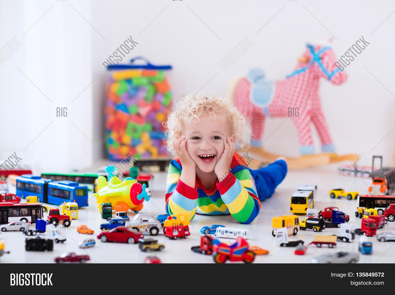 Big Boy Toys Games : Funny curly toddler boy playing his image photo bigstock