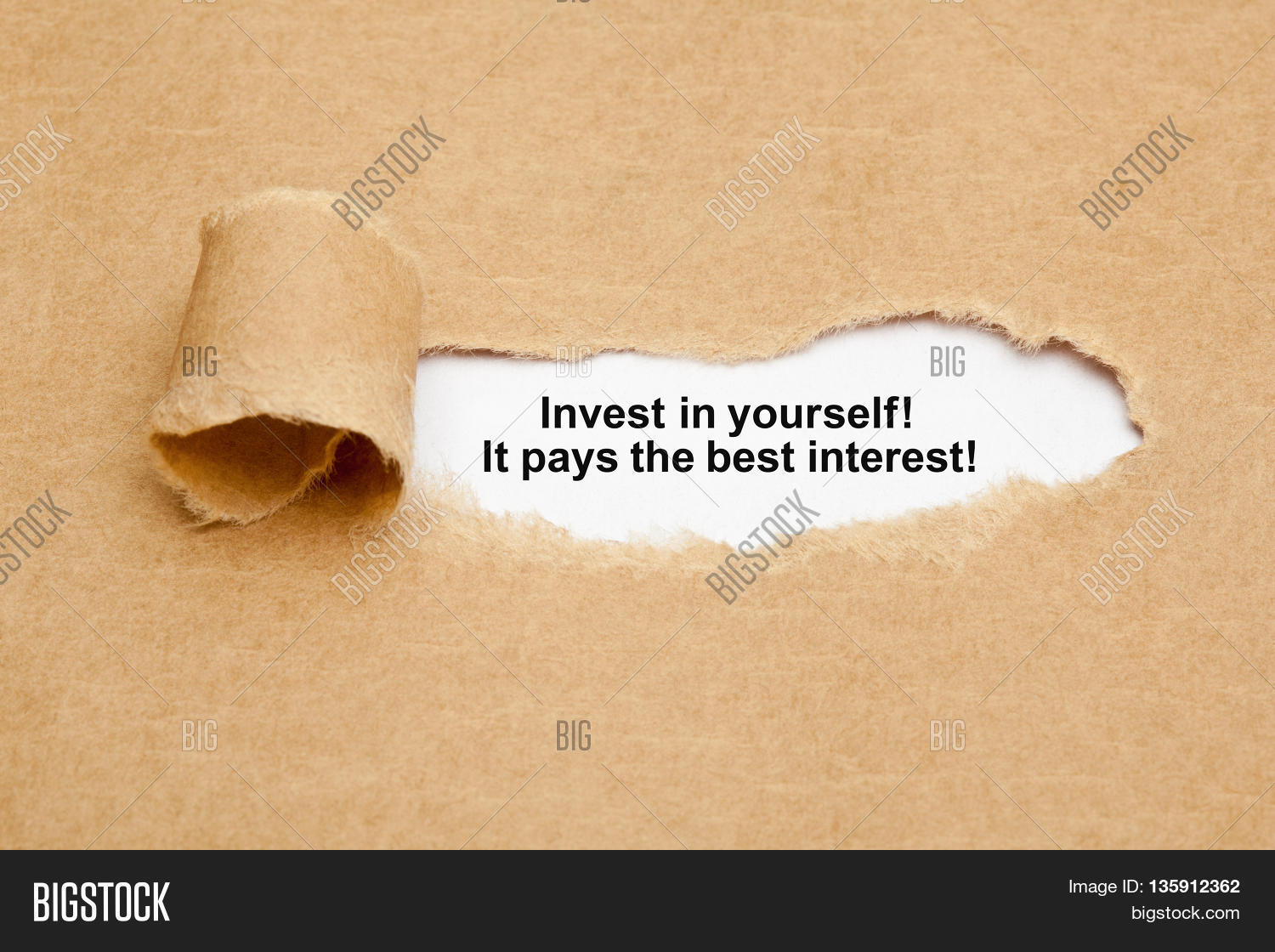 the quote invest in yourself it pays the best interest appearing the quote invest in yourself it pays the best interest appearing behind ripped brown paper