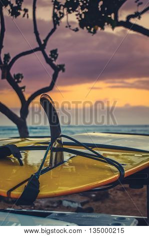 Detail Of A Surfboard On The Back Of A Truck By The bEach At Sunset In Hawaii