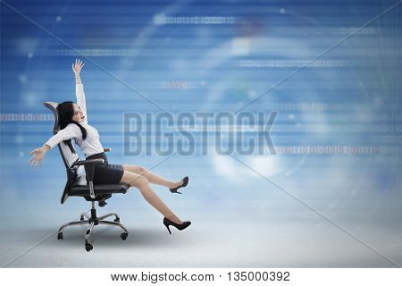 Concept of fast internet connection with a young businesswoman driving chair inside cyberspace