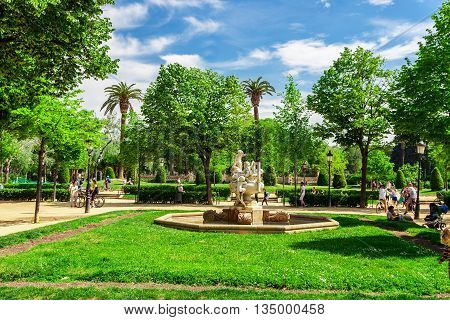 Barcelona, Spain - May 3, 2015: Barcelona Attractions, People walking and bicycling in the Botanical park De la Ciutadella in Barcelona, Catalonia, Spain.