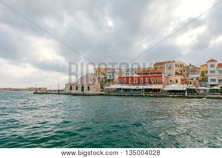 Scenic view Venetian embankment in Chania with the Mosque of Hassan Kuchuk Pasha early in the morning. Crete, Greece.