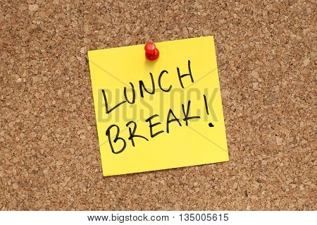 Lunch break note paper pinned on cork board