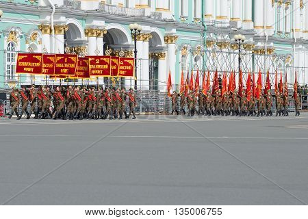 SAINT PETERSBURG, RUSSIA - MAY 05, 2015: The group of soldiers with banners of the Great Patriotic War. Rehearsal of parade in honor of Victory Day on Palace Square. St. Petersburg