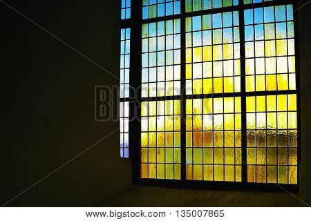 2016/06/18 - Chomutov city Czech republic - part of a large window in historical interior of the tower  'Mestska vez' during a sunny day in June