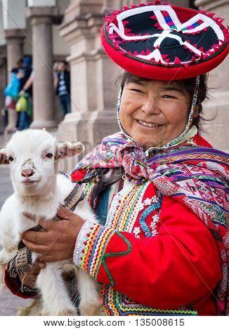Cuzco Peru - March 18 2015: Peruvian woman in traditional dresses pose for tourists in Cuzco Peru: Peruvian woman in traditional dresses pose for tourists in Cuzco Peru