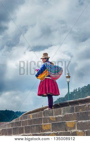 Cuzco Peru - March 18 2015: Peruvian woman in traditional dresses pose for tourists in Cuzco Peru: Peruvian woman in traditional dresses on the street in Cuzco Peru