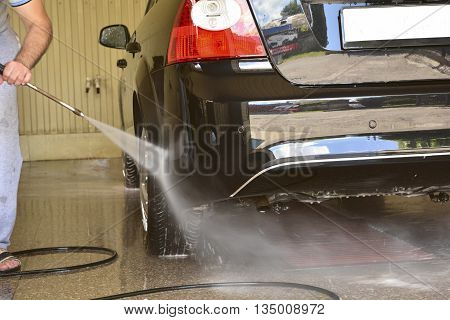 Car washing using high pressure water jet.