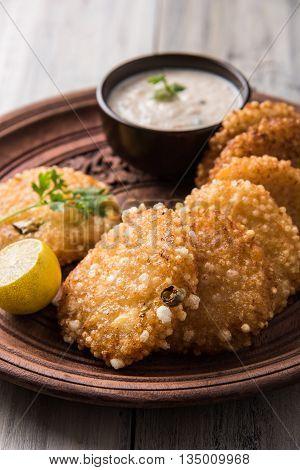 tasty sabudana vada or sabudana vade made up of Sago served with peanut chutney, a famous fasting recipe or snack from maharashtra, India