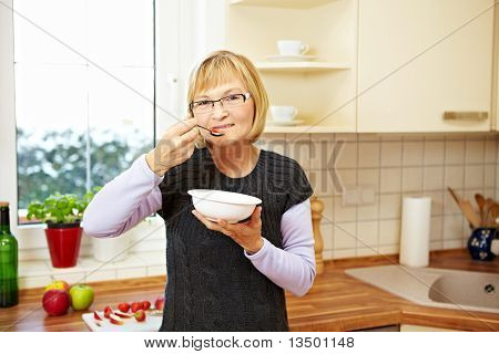 Senior Woman Eating Muesli
