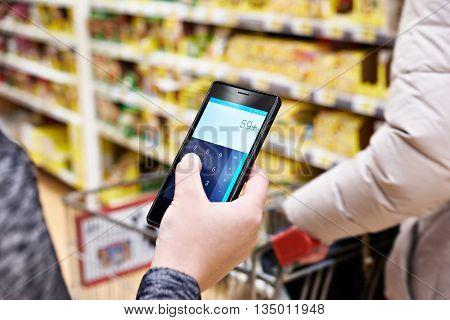 Calculator On Smartphone Screen In Hand Of Women Customers