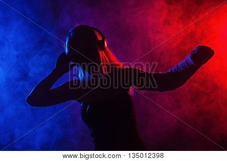 Girl Dancing With Broken Arm And Headphones
