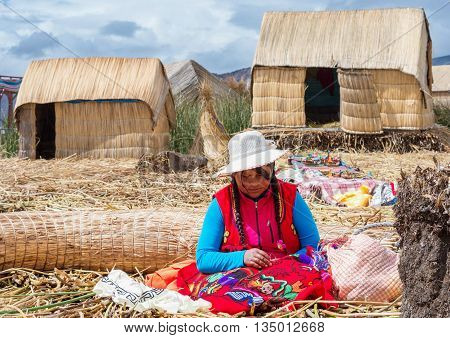People On Floating Uros Islands On Lake Titicaca In Peru