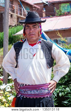 Man In  Traditional Clothes At Taquile Island At Lake Titicaca In Peru
