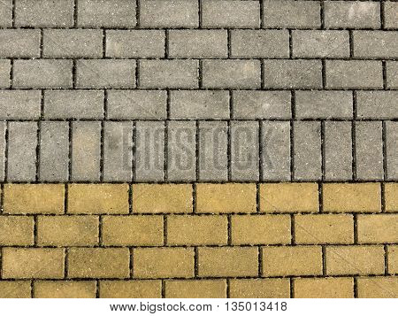 Sidewalk from brick tiles. Yellow, brown, grey color Horizontal view
