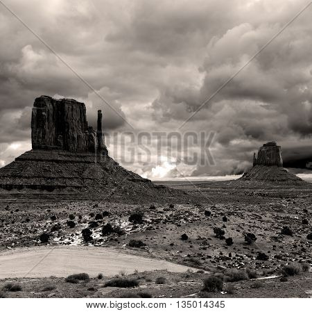 Sepia toned Monument Valley Arizona with stormy cloudy skies