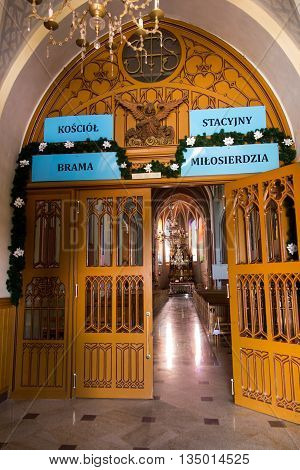 Sokolow Malopolski Poland - June 9 2016: The interior gate of mercy of the shrine the Church of St. John Baptist in Sokolow Malopolski in Poland with the image of Mary in the crowns of the Shrine of Our Lady Queen of the World - Nursing Human Roads