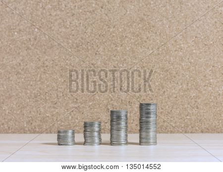 stair to wealth made from coins stacked increasing on wooden table with copy space business success and financial concept