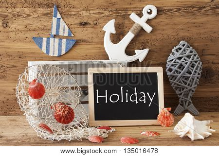 Blackboard With Nautical Summer Decoration And Wooden Background. English Text Holiday. Fish, Anchor, Shells And Fishnet For Maritime Contex.