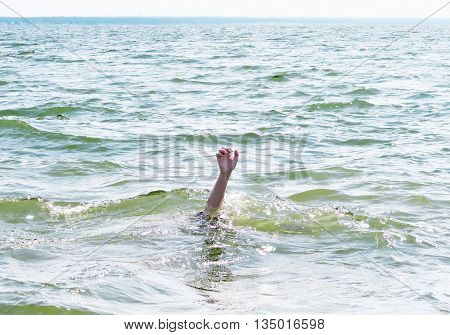 Person with Hand Up in the Water
