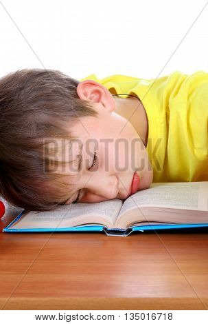 Tired Kid Sleep on the School Desk on the White Background