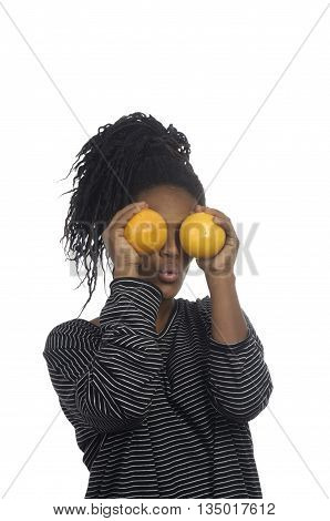 Teenage girl playing with an orange on white background
