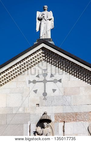 Medieval statue of a winged angel on top of the Modena's cathedral a UNESCO World Heritage Site in Modena Italy
