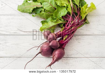 Beetroots on wooden background, top view.