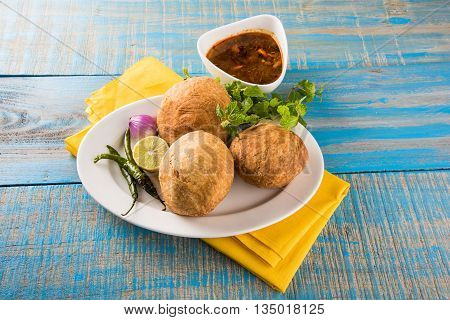 Kachori or Kachauri or Kachodi or Katchuri is a spicy snack popular in india, asian snacks, pakistani snacks with tea and green salad and tomato ketchup