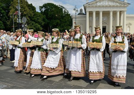 VILNIUS, LITHUANIA - JULY 6: Unidentified peoples parade in traditional Lithuanian Song Celebration on July 6, 2014 in Vilnius, Lithuania