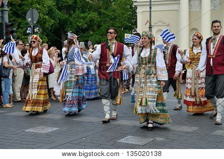 VILNIUS, LITHUANIA - JULY 6: Unidentified peoples parade (guests from Uruguay) in traditional Lithuanian Song Celebration on July 6, 2014 in Vilnius, Lithuania