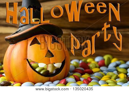 halloween pumpkin with chocolate candy and halloween party written