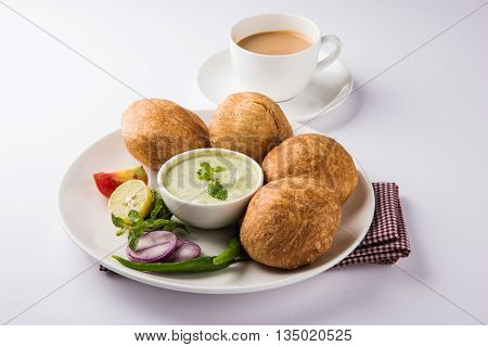 Kachori or Kachauri or Kachodi or Katchuri is a spicy snack popular in india, asian snacks, pakistani snacks with tea and green salad and tomato