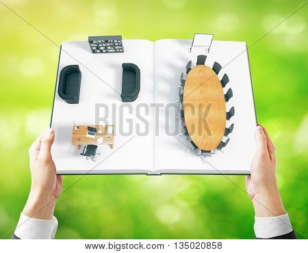 Businessman hands holding open book with abstract office interior on green background. 3D Rendering