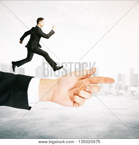 Guidance concept with businessman running on abstract arm pointing forward on foggy city background