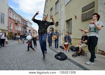 VILNIUS, LITHUANIA - MAY 17: Unidentified musicians dancing and play guitar in Street music day on May 17, 2014 in Vilnius. Its a most popular event on May in Vilnius, Lithuania