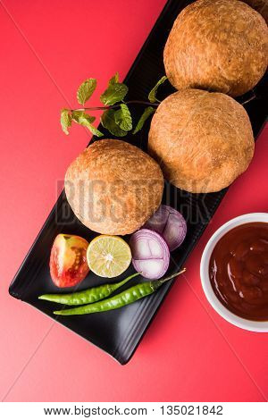 Kachori or Kachauri or Kachodi or Katchuri is a spicy snack popular in india, asian snacks, pakistani snacks with green salad and tomato ketchup