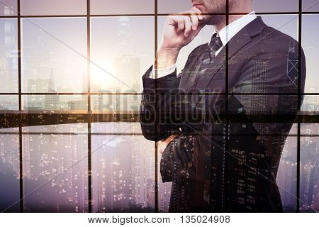 Thoughtful businessman on interior and city background. Double exposure