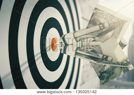 Closeup of dartboard with dollar banknote darts. Concept of targeting. 3D Rendering