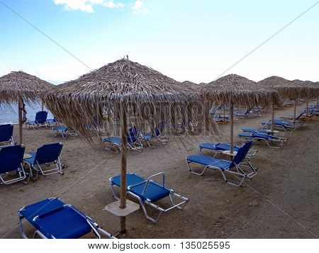 The sunbeds and canopies on the beach